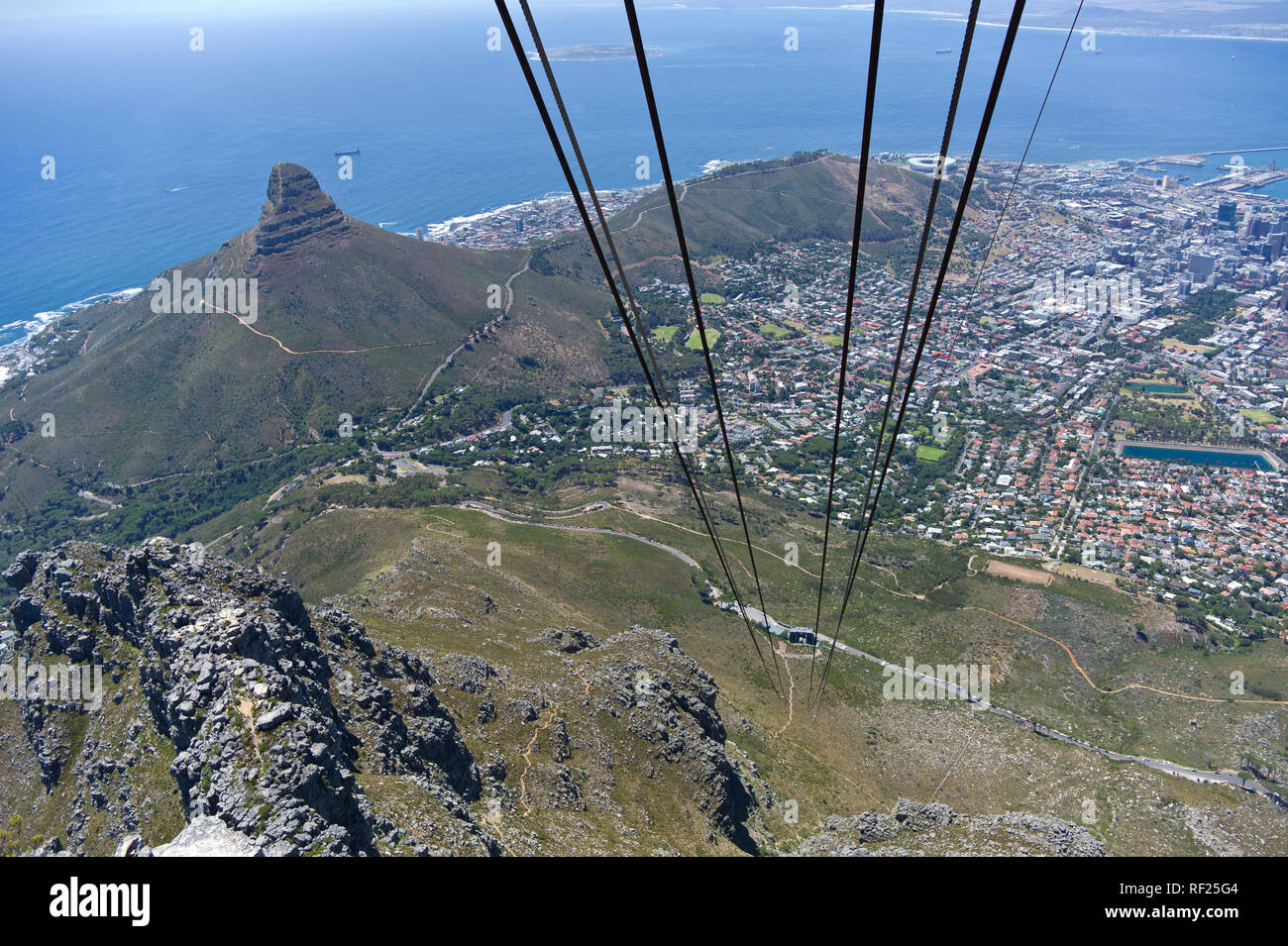 The Table Mountain cable car is one way to get to the top of the mountain that affords stunning views of the city and the hiking routes below. - Stock Image