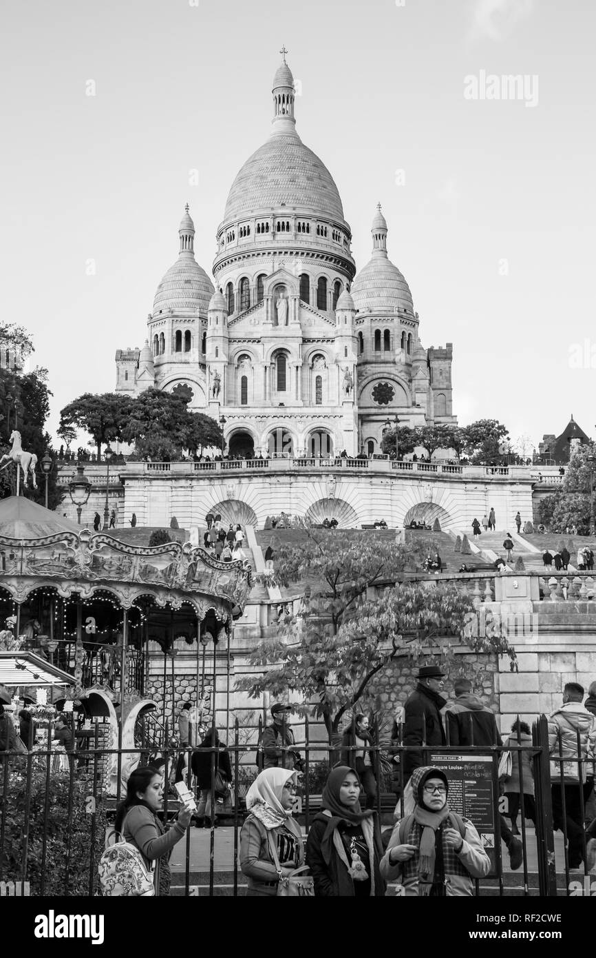 PARIS, FRANCE - NOVEMBER 9, 2018 - Basilica of the Sacred Heart of Paris, or Montmartre Sacré-Cœur, is a popular landmark and the 2nd most visited mon Stock Photo