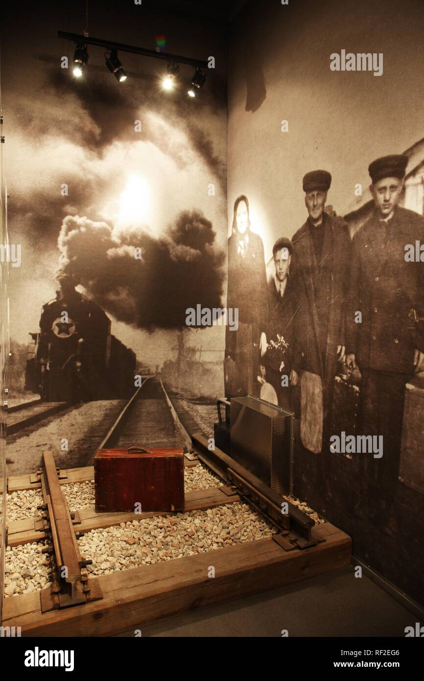 Suitcase between railway tracks in the KGB Museum, Genocide Museum, dealing with the periods of German and Soviet occupations - Stock Image