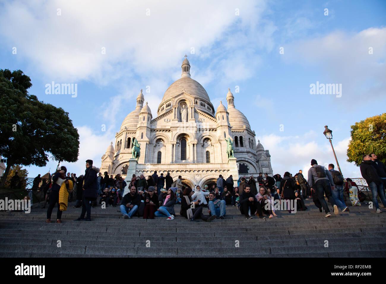 PARIS, FRANCE - NOVEMBER 9, 2018 - Basilica of the Sacred Heart of Paris, or Montmartre Sacré-Cœur, is a popular landmark and the 2nd most visited mon Stock Photo