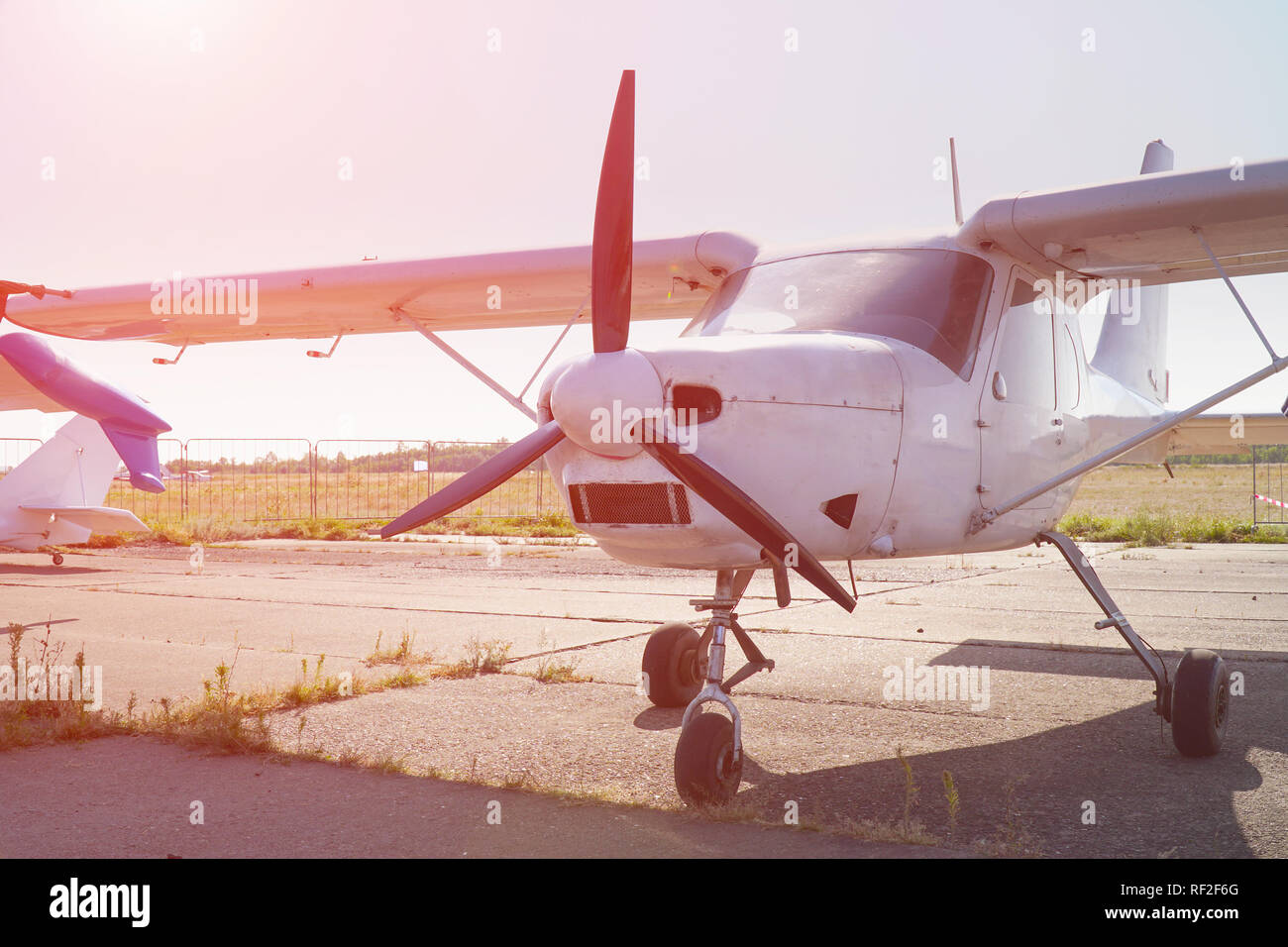 Light single-engine aircraft at the airport. Front view - Stock Image