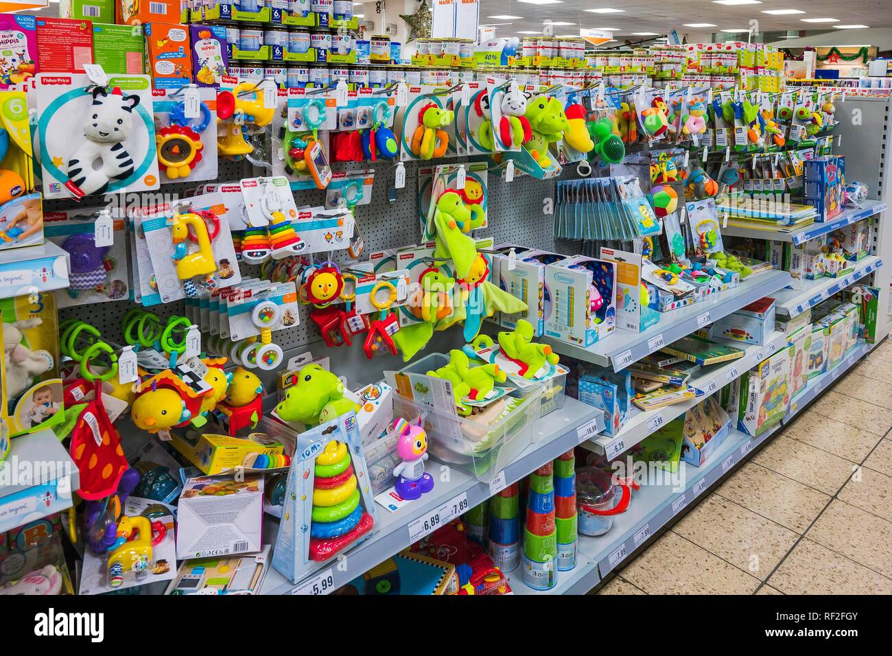 Colorful toys for toddlers in supermarkets, Munich, Upper Bavaria, Bavaria, Germany - Stock Image