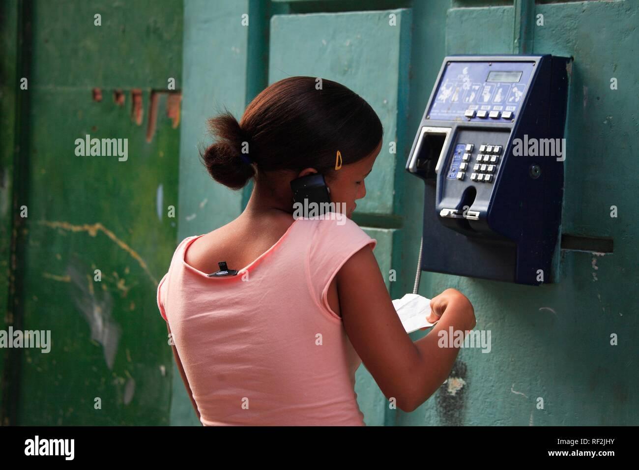Local woman at a public telephone, Havana, Cuba, Caribbean - Stock Image