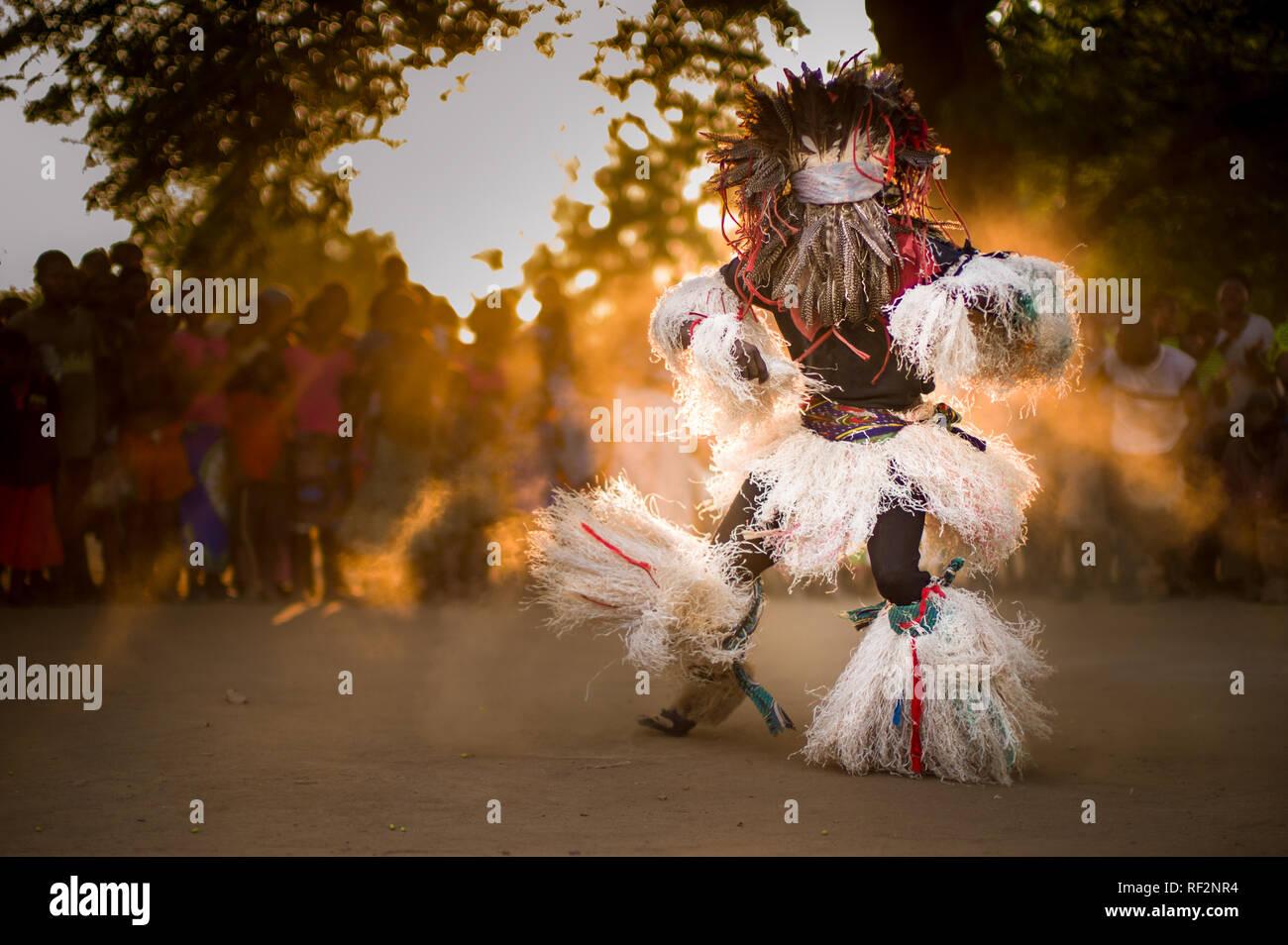 A Gule Wamkulu dancer in an energetic performant near Chikwawa, Malawi; the Gule Wamkulu is a captivating ritual dance performed by a secret society Stock Photo