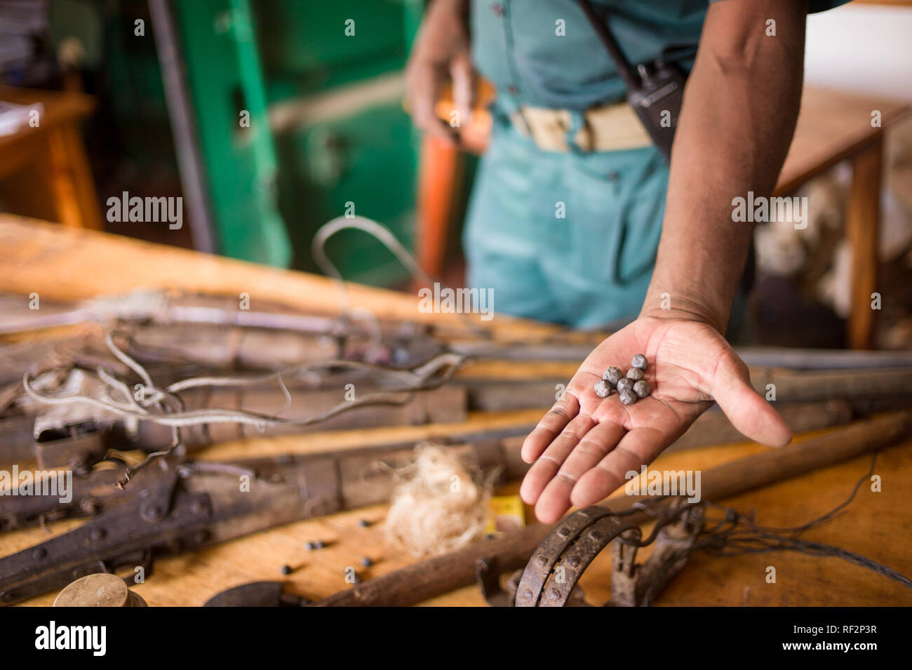 Illegal homemade muzzle loading guns and bullets are confiscated from poachers at the Majete Wildlife Reserve in Malawi and kept in a vault by rangers. - Stock Image