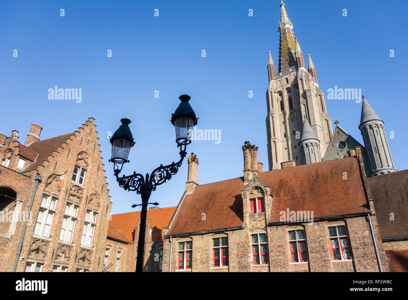 Sint-Janshospitaal / St John's Hospital and church tower of the Church of Our Lady / Onze-Lieve-Vrouwekerk in the city Bruges, West Flanders, Belgium - Stock Image