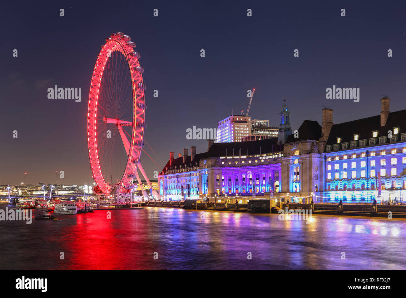 Westminster, London, 23rd Jan 2019. The sun sets and night falls over Big Ben, the Houses of Parliament, Westminster Bridge and the River Thames in Westminster, following a cold and relatively calm day in the capital. Credit: Imageplotter News and Sports/Alamy Live News Stock Photo