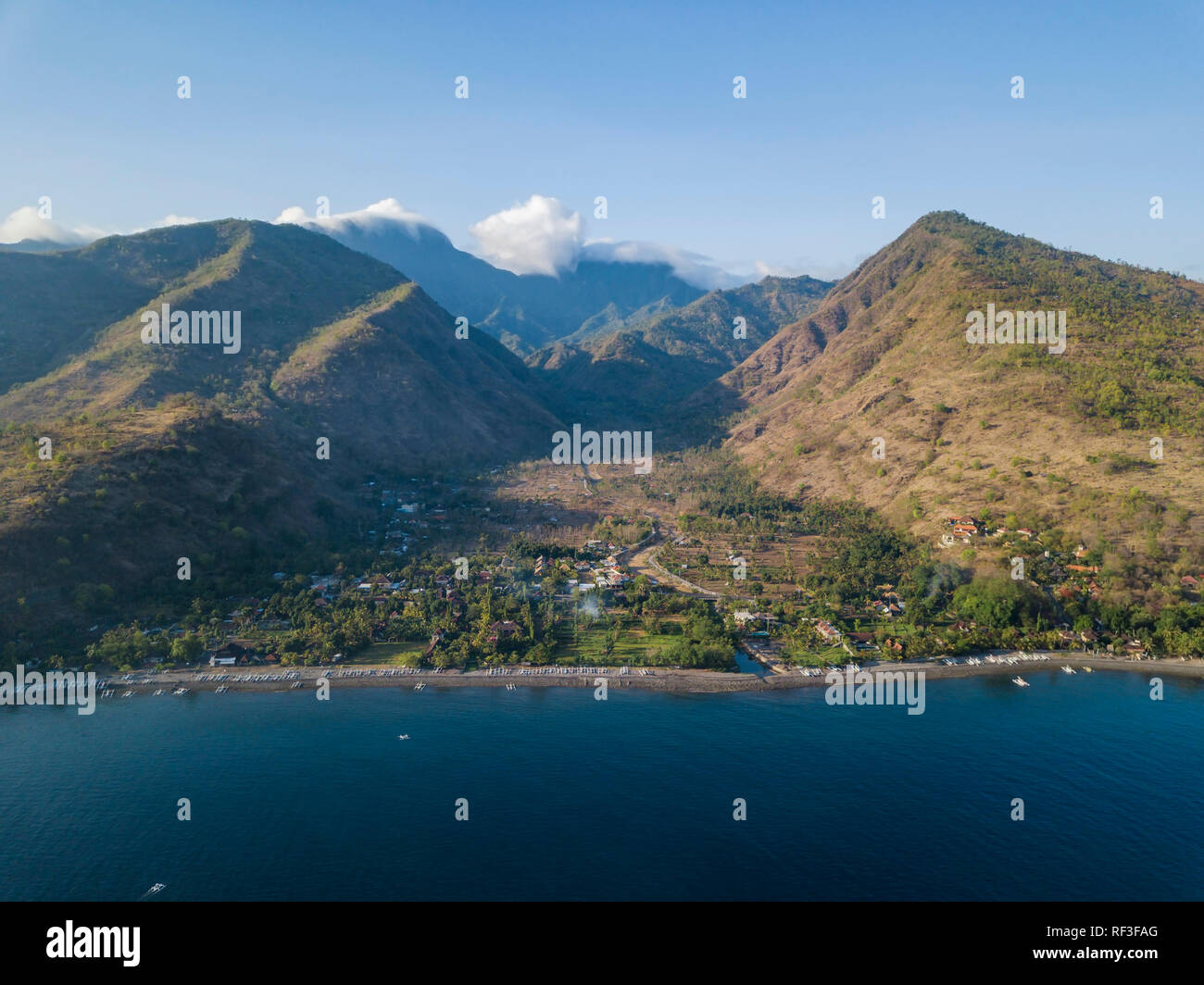 Indonesia, Bali, Amed, Aerial view of Lipah beach and volcano Agung - Stock Image