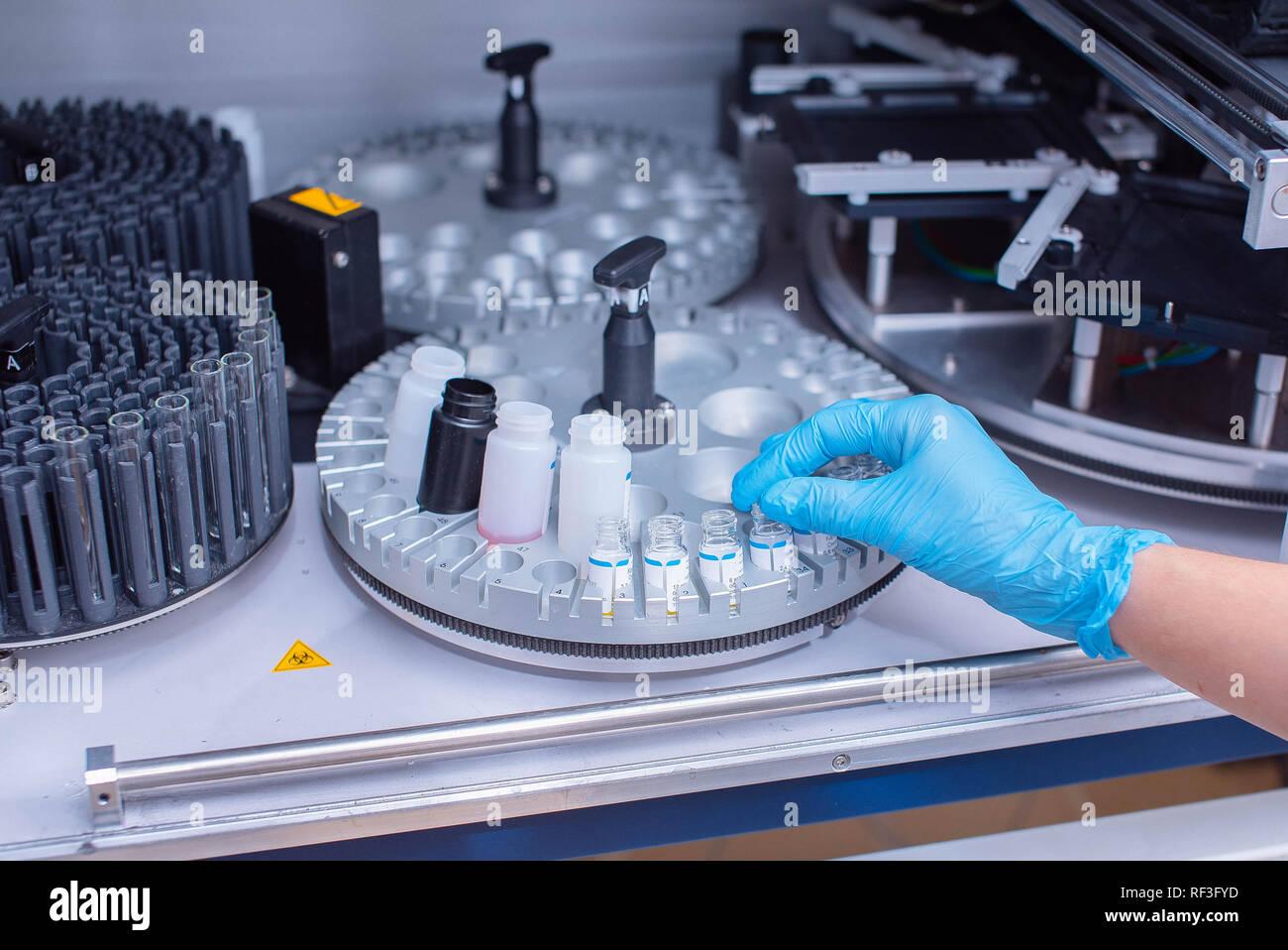 Laboratory immunoassay analyzer. Diagnosis of infectious diseases and allergic reactions. Prenatal screening. Analysis of the hormonal status. - Stock Image