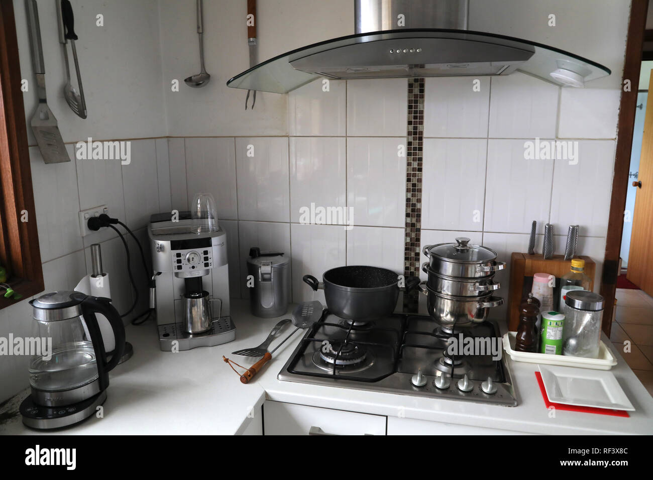 Cooking accessories in kitchen with coffee machine ...