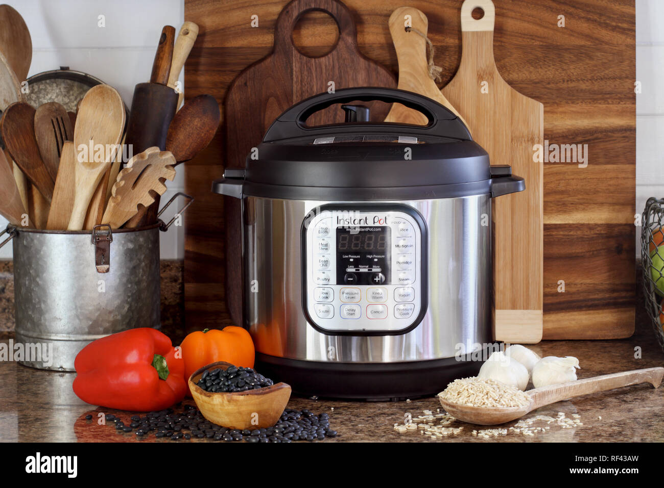 Breeding, KY, USA - January 08, 2019: Instant Pot pressure cooker on kitchen counter with beans and rice. - Stock Image