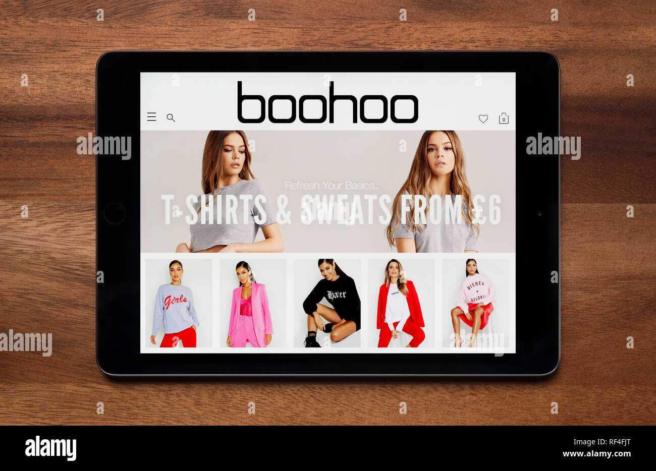 94163e0608c The website of Boohoo is seen on an iPad tablet, which is resting on a