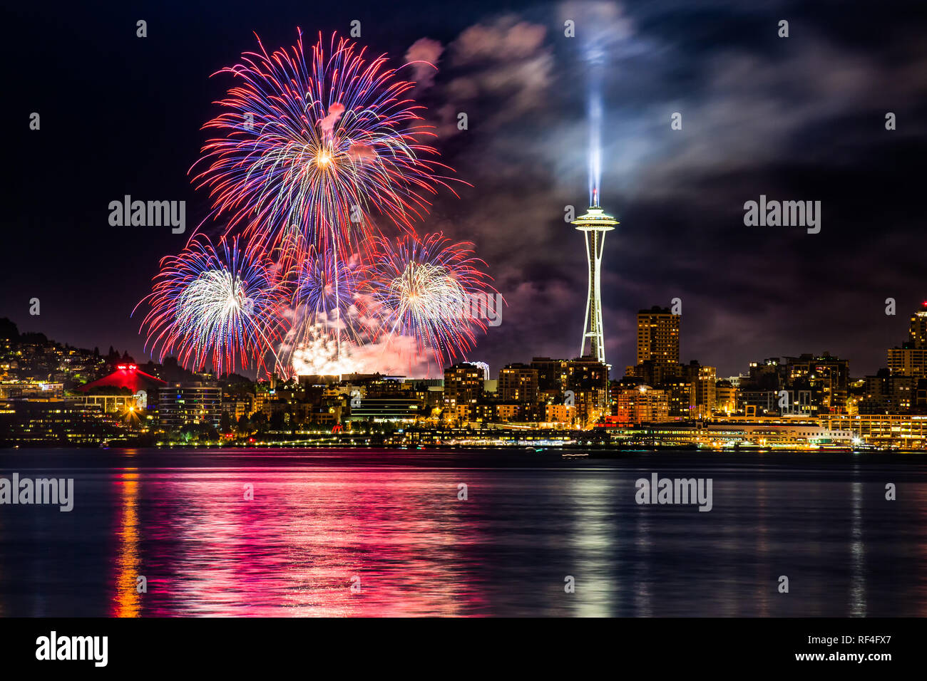 Lake Union 4th of July Fireworks and the Seattle skyline, as seen from across Elliott Bay at Seacrest Park in West Seattle, WA, USA - Stock Image