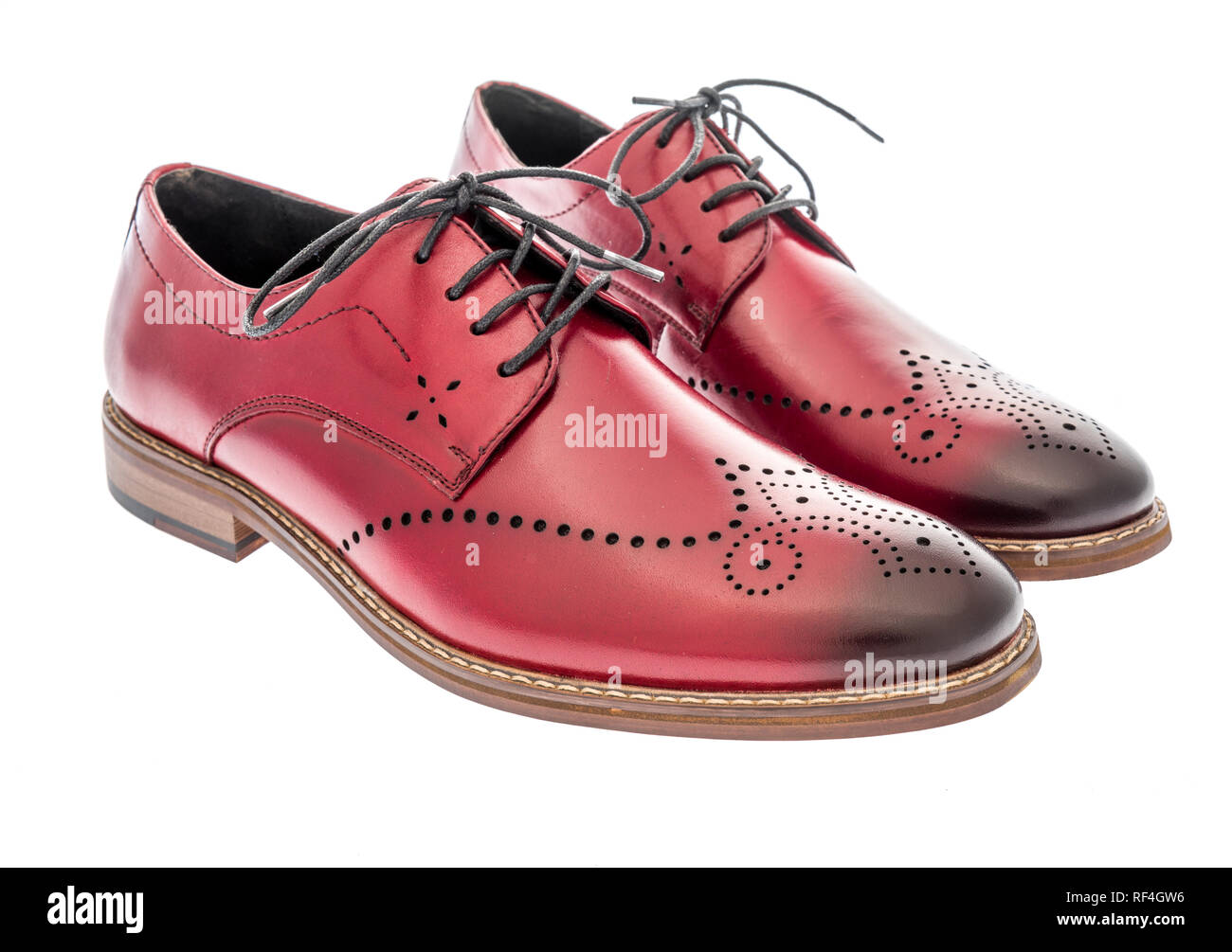 ce81f16d A pair of red wing tip dress shoes on an isolated background Stock ...