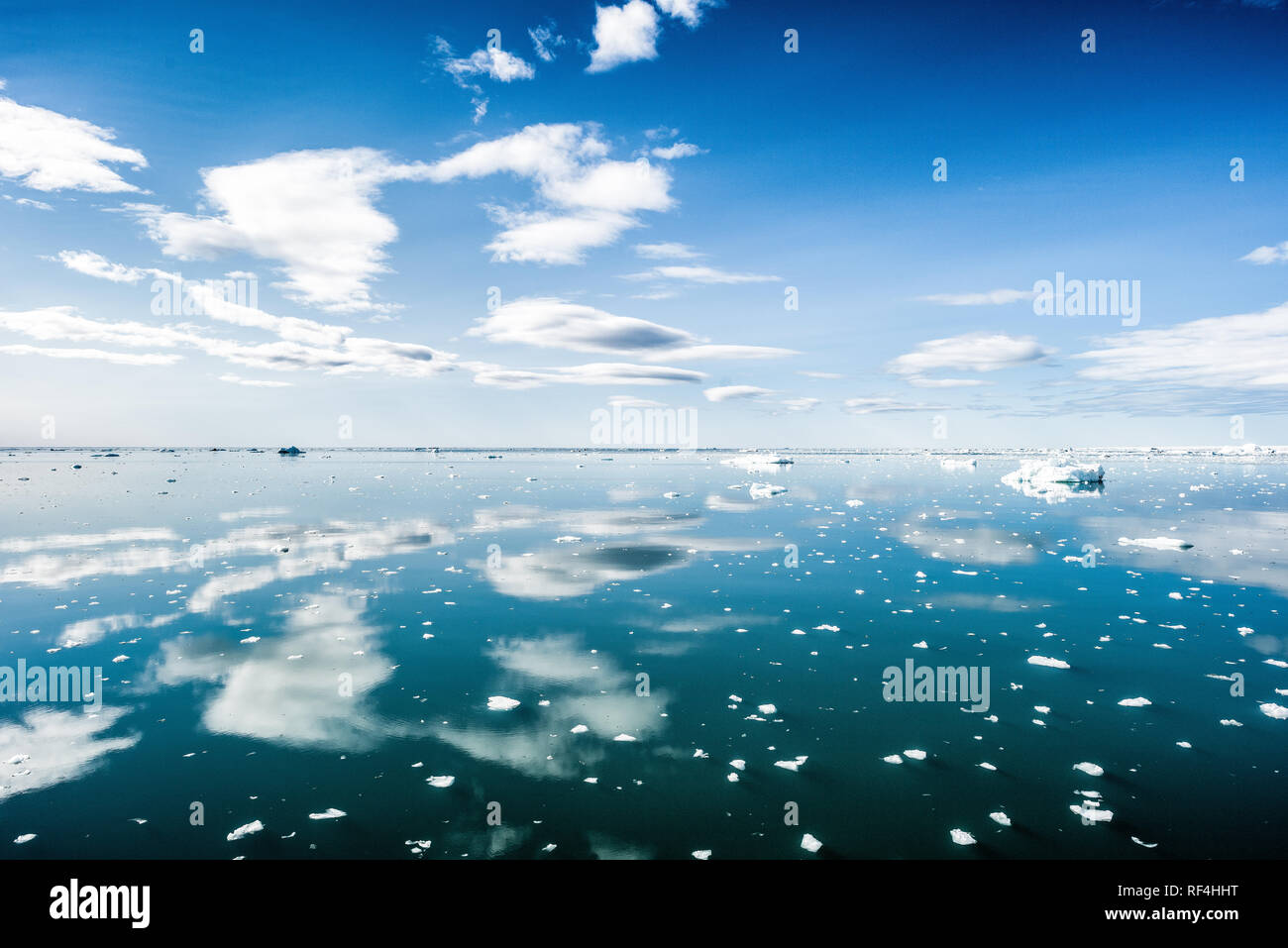 NORDAUSTLANDET, Svalbard - Ice and calm waters next to the massive Bråsvellbreen glacier on Nordaustlandet, the second-largest island in the Svalbard archipeligo. - Stock Image