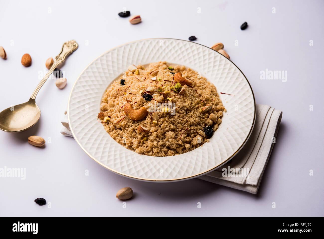 Semolina Halwa / Sooji ka Halva or sweet Rava Sheera or shira - Indian festival sweet made of semolina, nuts and Ghee - Stock Image