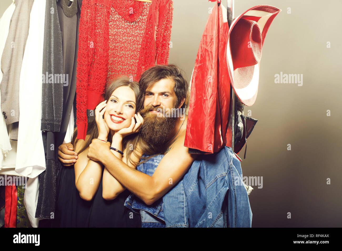 Fashion couple in closet - Stock Image