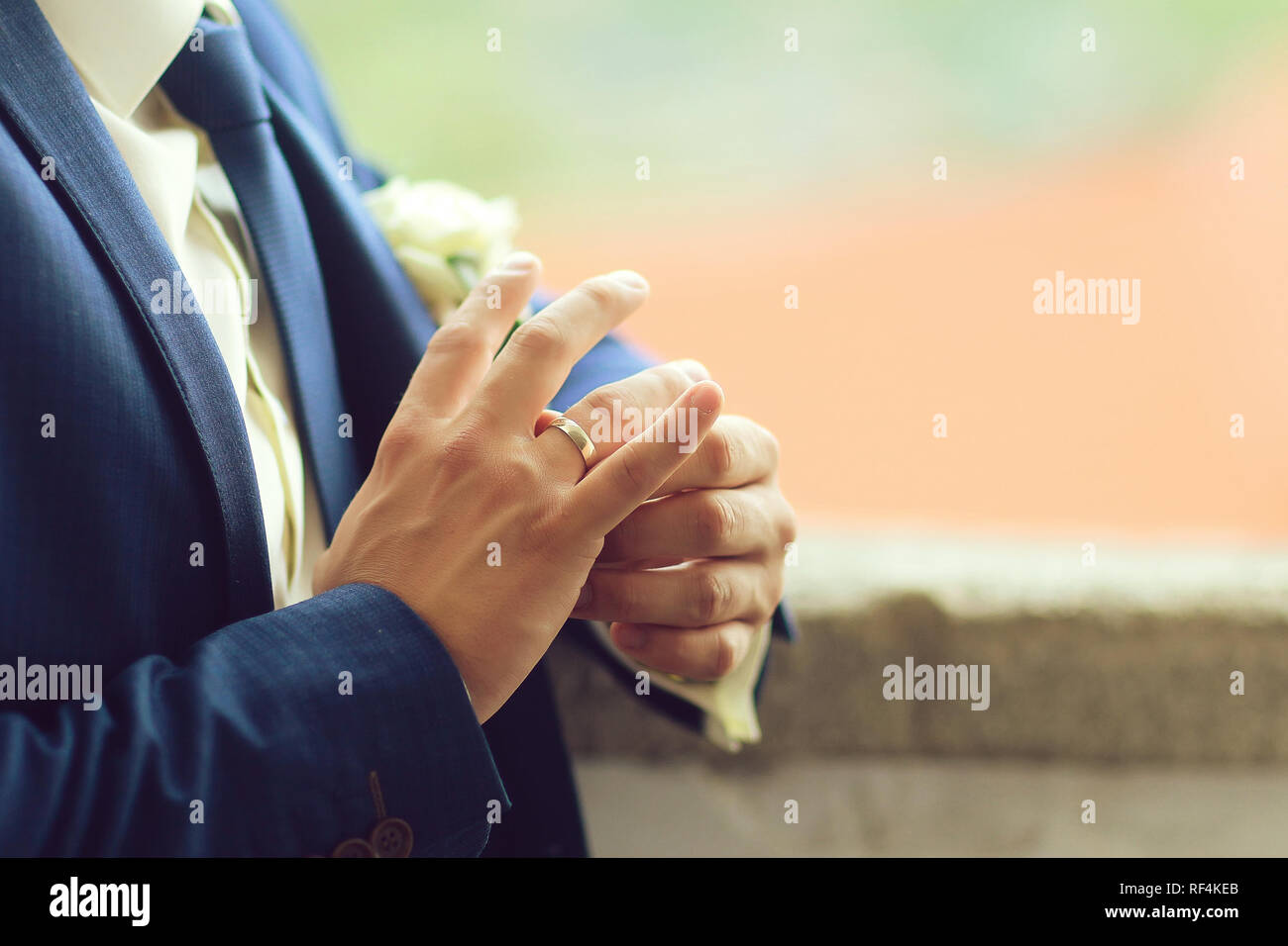 Groom touches wedding ring - Stock Image