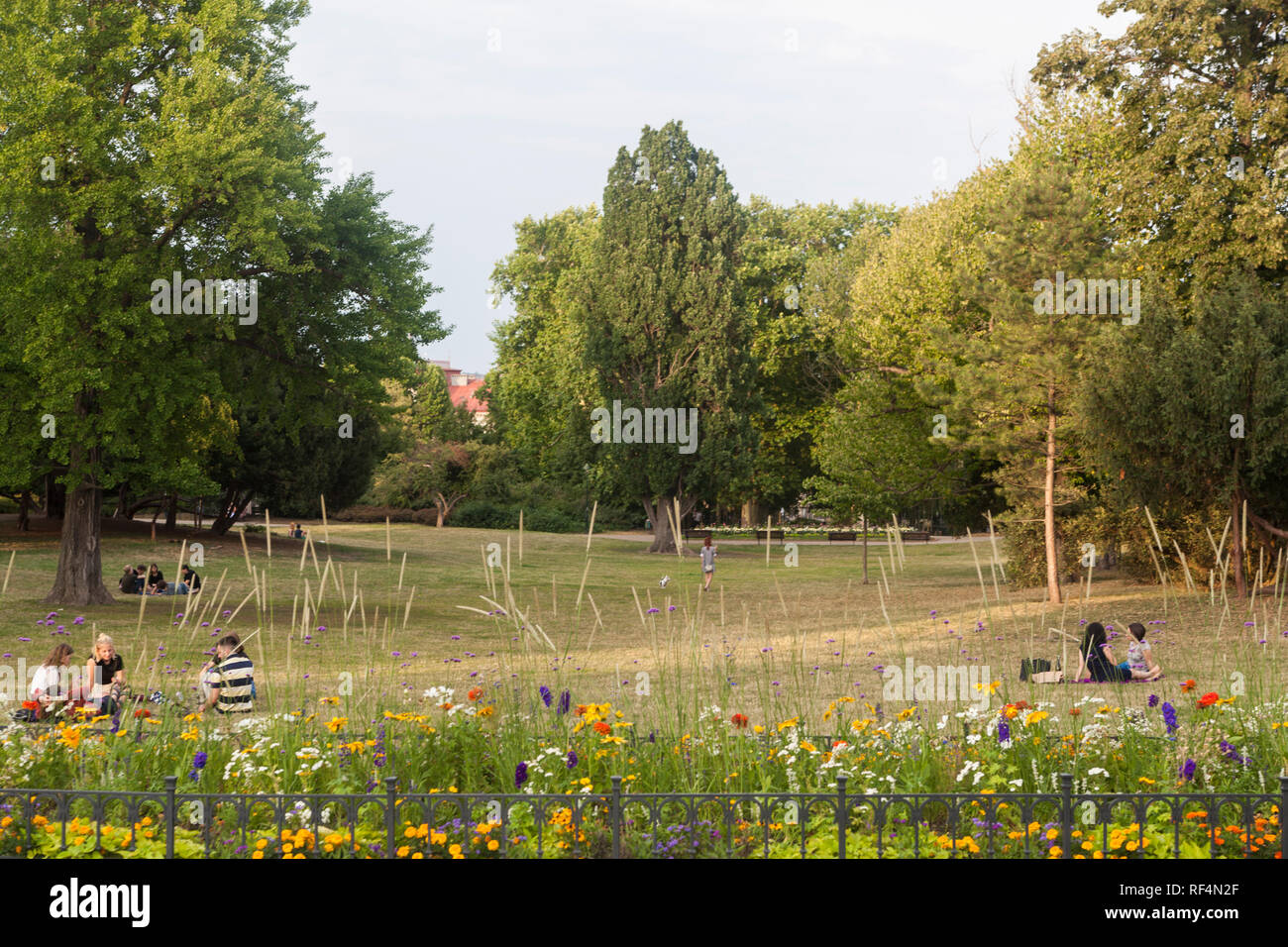 Prague, Czech Republic - July 17 2018: People enjoying evening sun on a lawn in Letna park Stock Photo