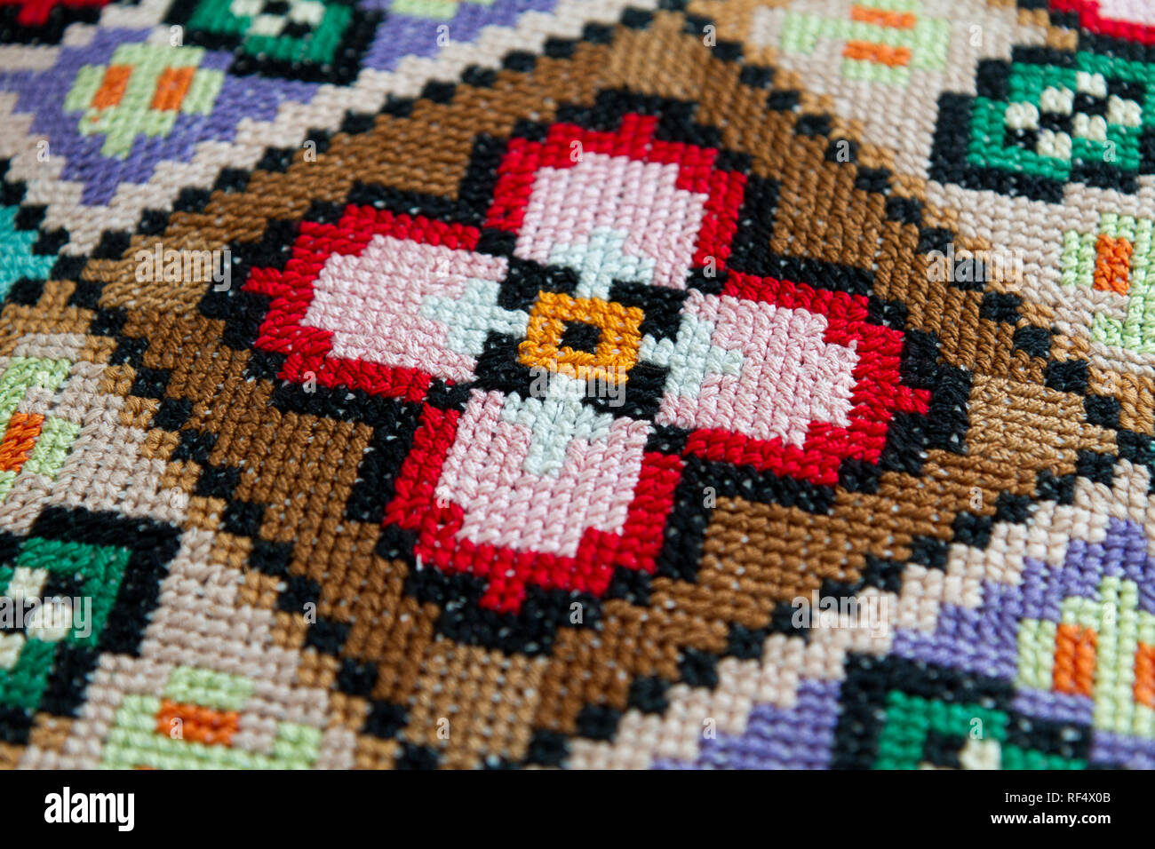 traditional patterns of Slavic embroidery (a colourful pillow case, second half of the 20th century, Slovakia) Stock Photo