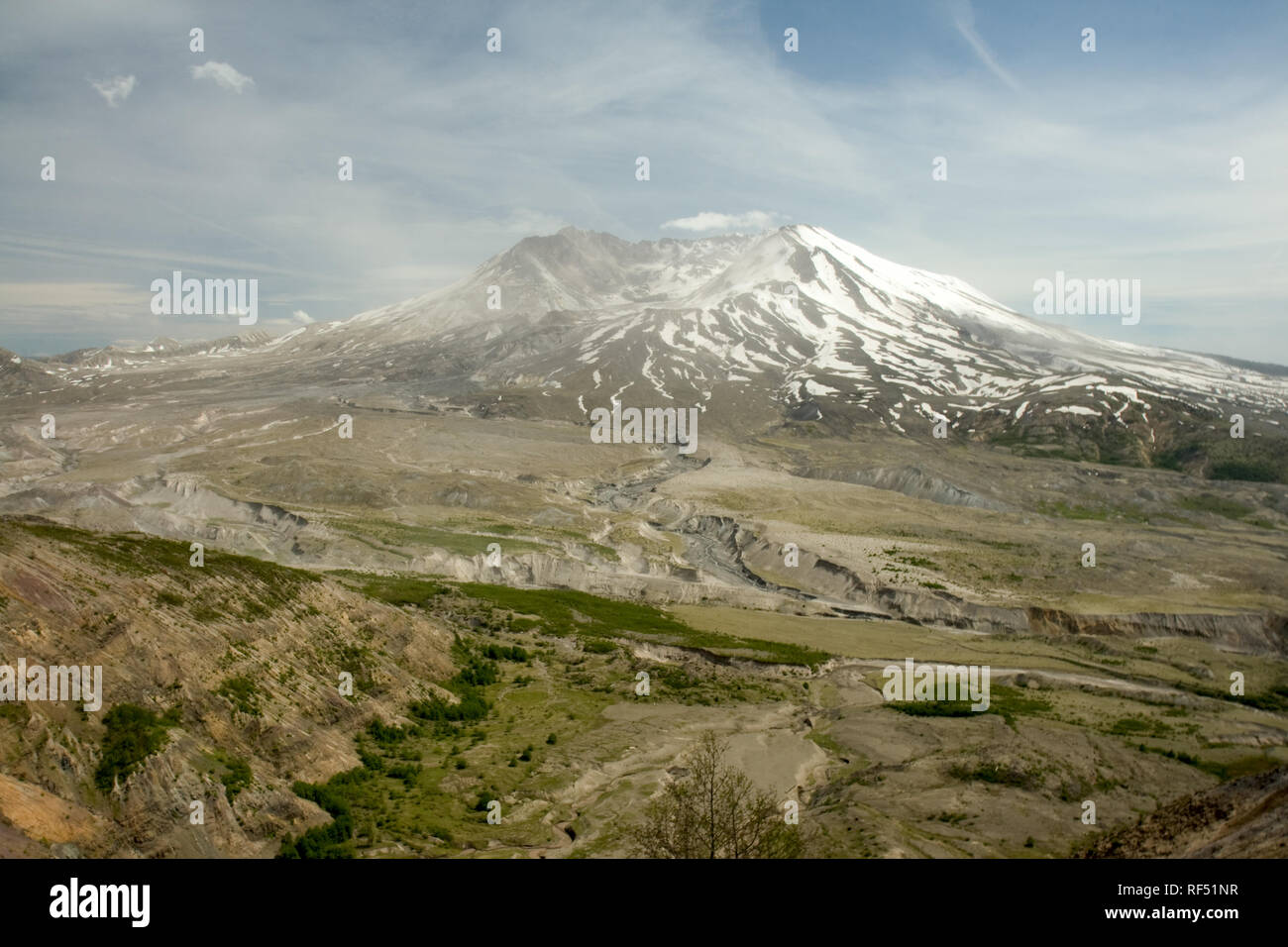 Desolation still blankets the land as a new cinder cone forms within the crater of Mount Saint Helens. - Stock Image