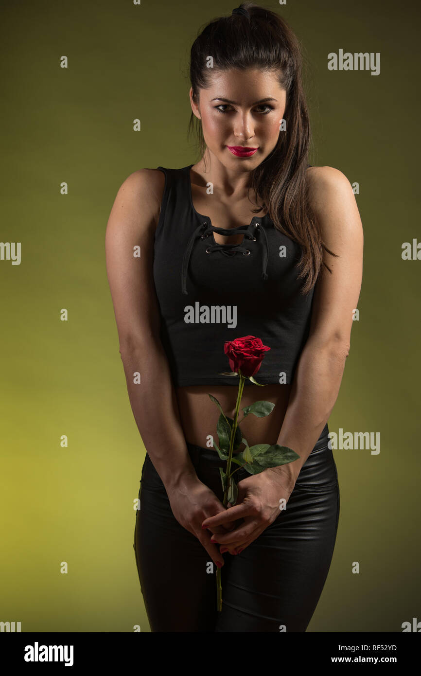 beautiful young woman, holding red rose and smile Stock Photo