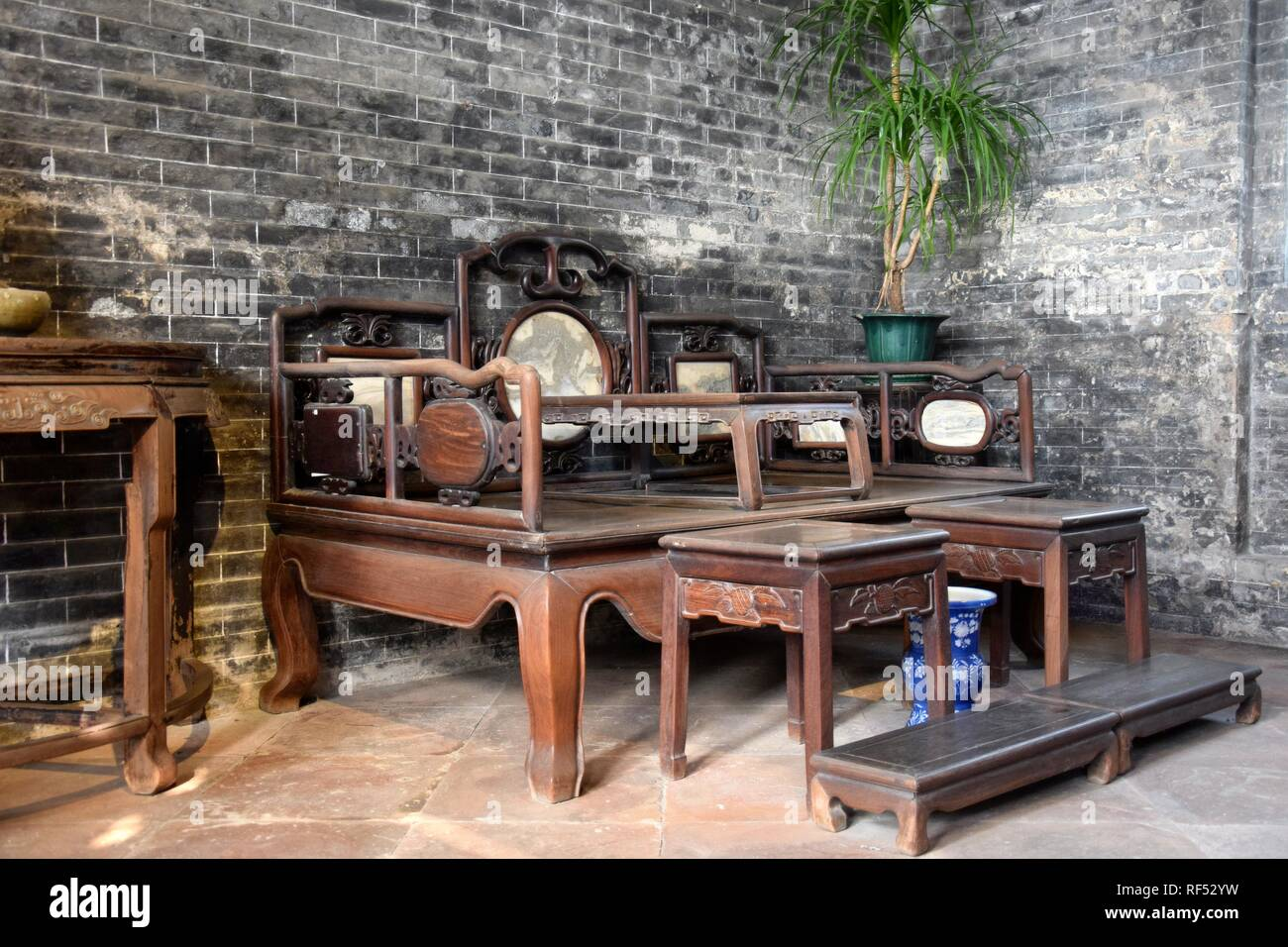 Interior with antique wooden furniture. Traditional room of wealthy chinese family. - Stock Image