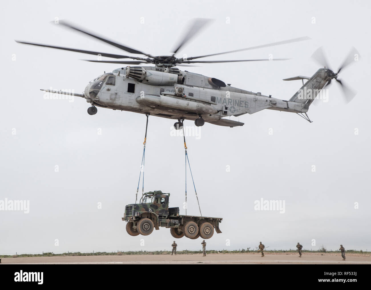 MARINE CORPS AIR STATION MIRAMAR, Calif.- A CH-53E Super Stallion with Marine Heavy Helicopter Squadron (HMH) 462, Marine Aircraft Group (MAG) 16, 3rd Marine Aircraft Wing (MAW), lifts a Medium Tactical Vehicle Replacement (MTVR) at Marine Corps Air Station Miramar, Calif., Jan. 16. Marines from HMH-462 and 1st Marine Logistics Group conducted an external lift of an MTVR to improve their support capabilities and exercise the aircraft's limit of 36,000 pounds. (U.S. Marine Corps photo by Lance Cpl. Clare J. McIntire) Stock Photo
