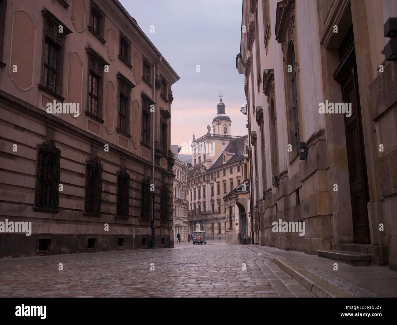 Baroque Architecture, Cobblestone Sidewalk and Light Snow Falling - Stock Image