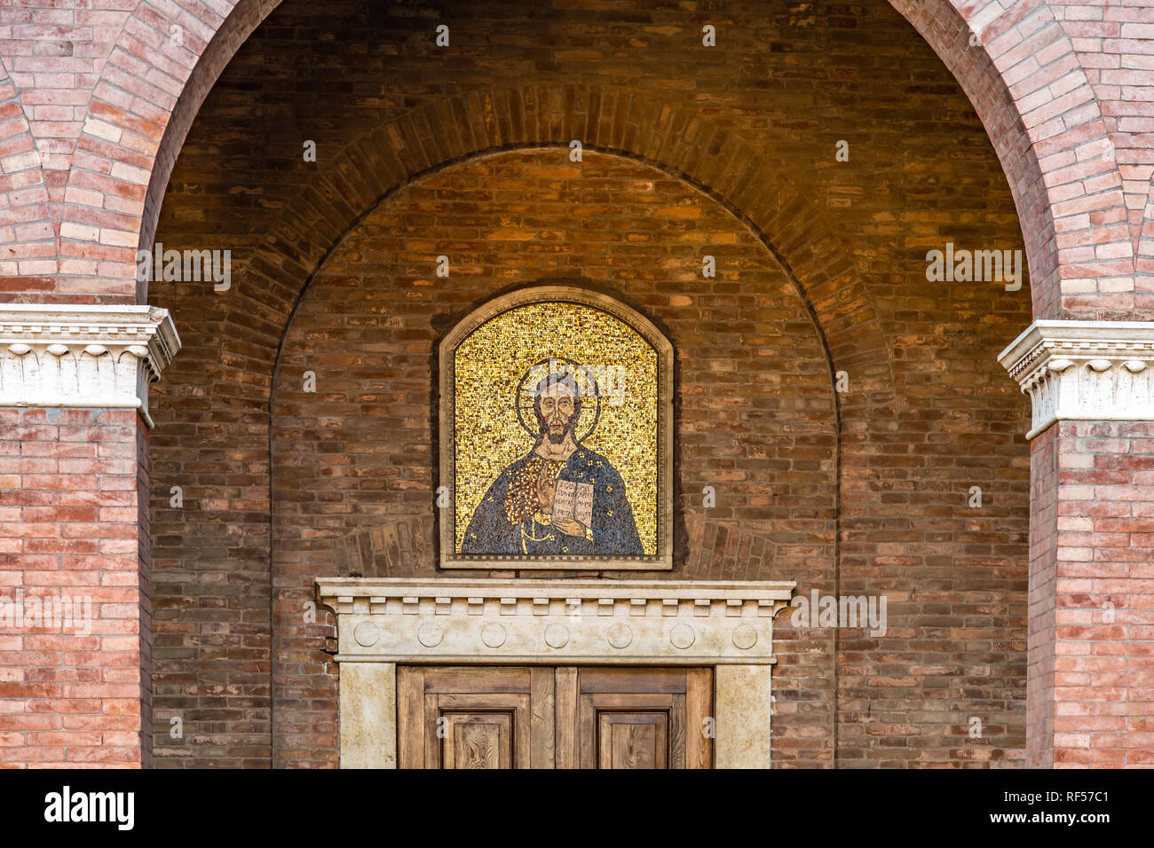 ROME, ITALY - JANUARY 4, 2019: sun light is enlightening mosaic of Jesus Christ in Saint Anselm of Canterbury church - Stock Image