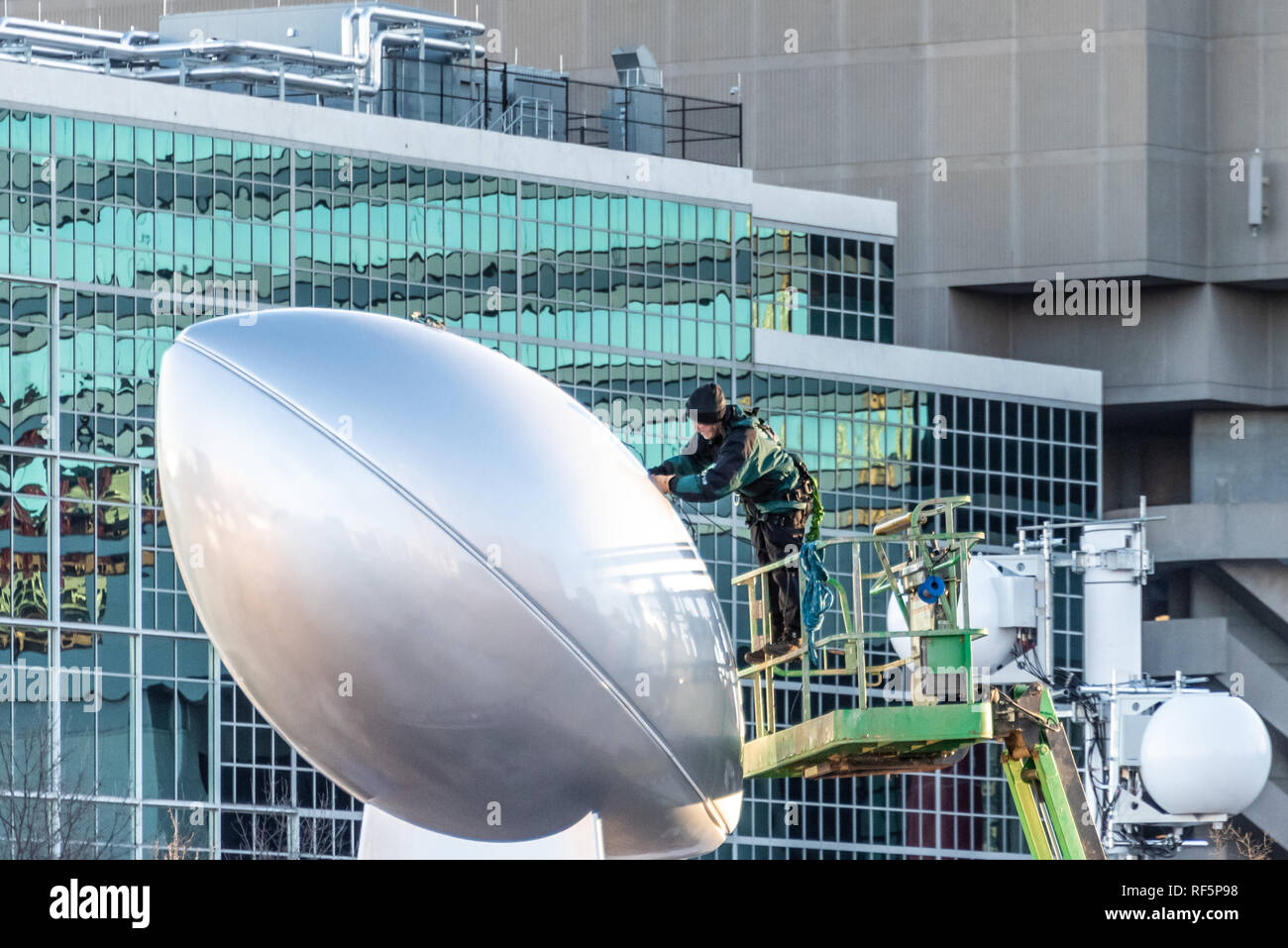 Worker prepares for Super Bowl LIII with installation of giant Vince  Lombardi Trophy sculpture in Atlanta f2f28a81d