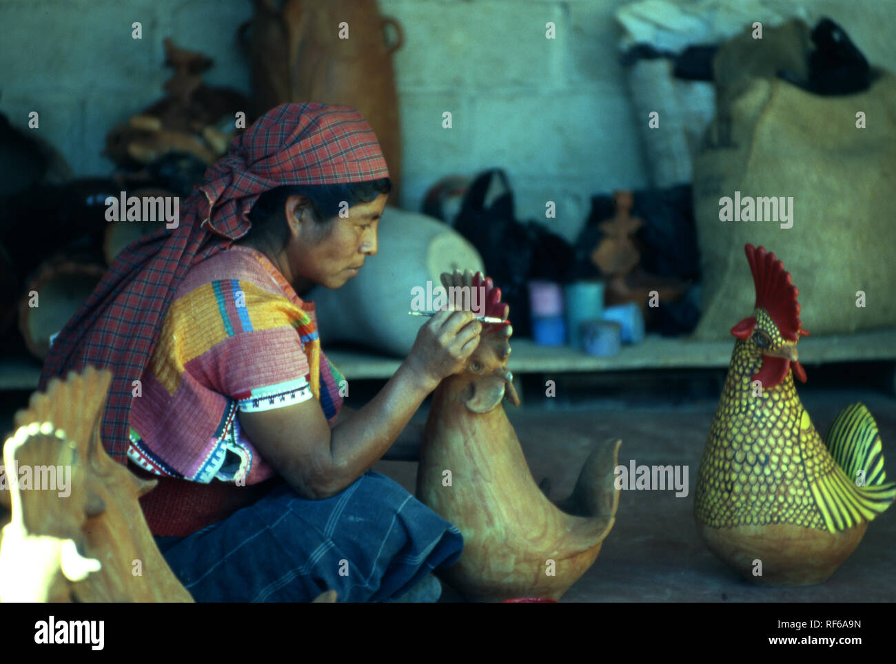 An indigenous Tzeltal woman paints 'animalitos' before they go on sale in Amatenango del Valle, Chiapas State, Mexico. - Stock Image