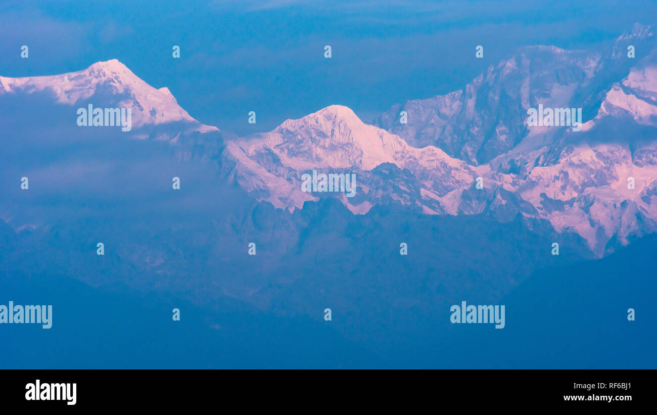 Kanchenjunga Mountain range covered with snow from Kaluk, West Sikkim,India. - Stock Image