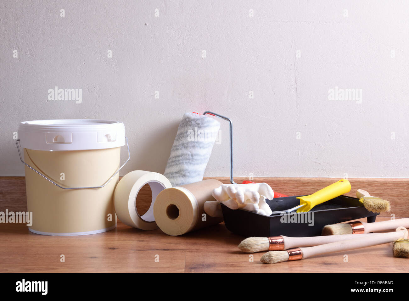 Painting Tools For Home On Table With White Wall Background