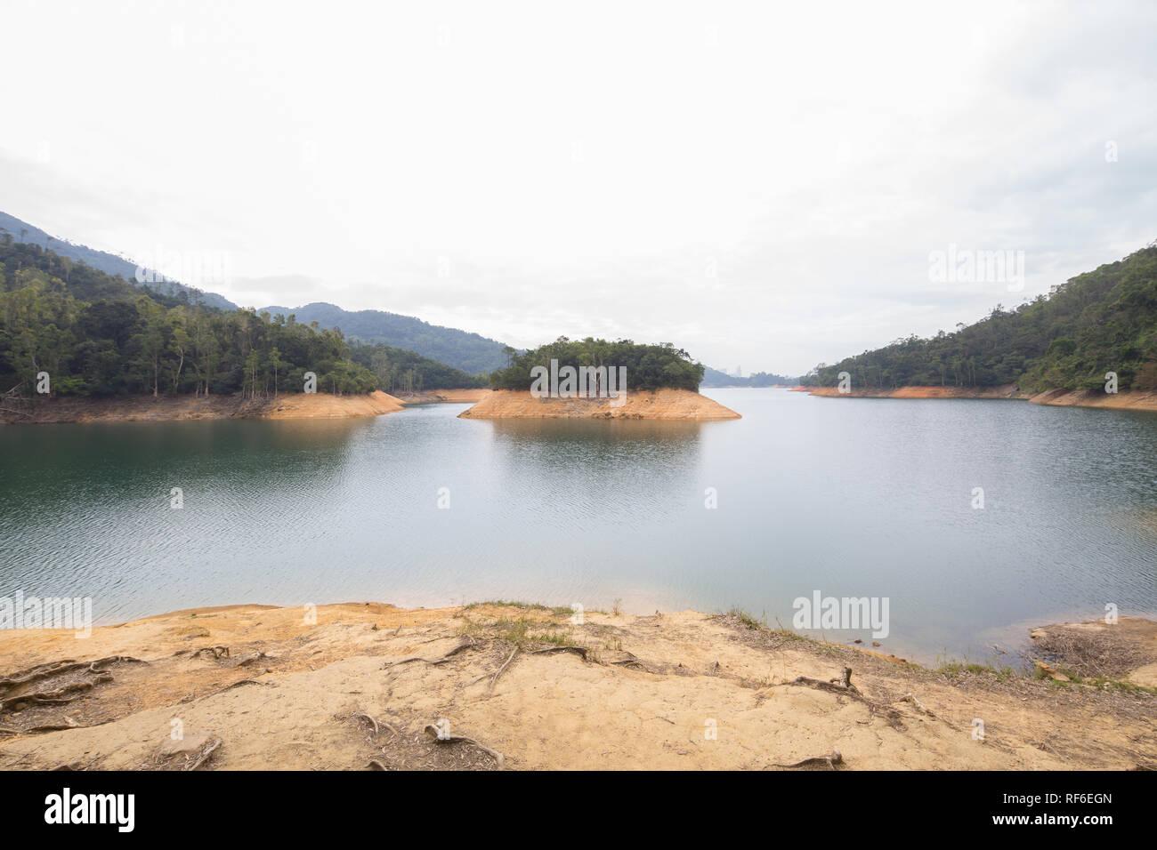 View of Shing Mun Reservoir from the bank, Hong Kong - Stock Image