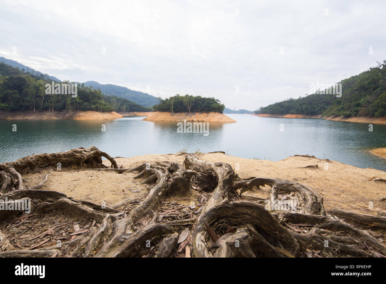 Scenery view of Shing Mun Reservoir from the bank, Hong Kong - Stock Image