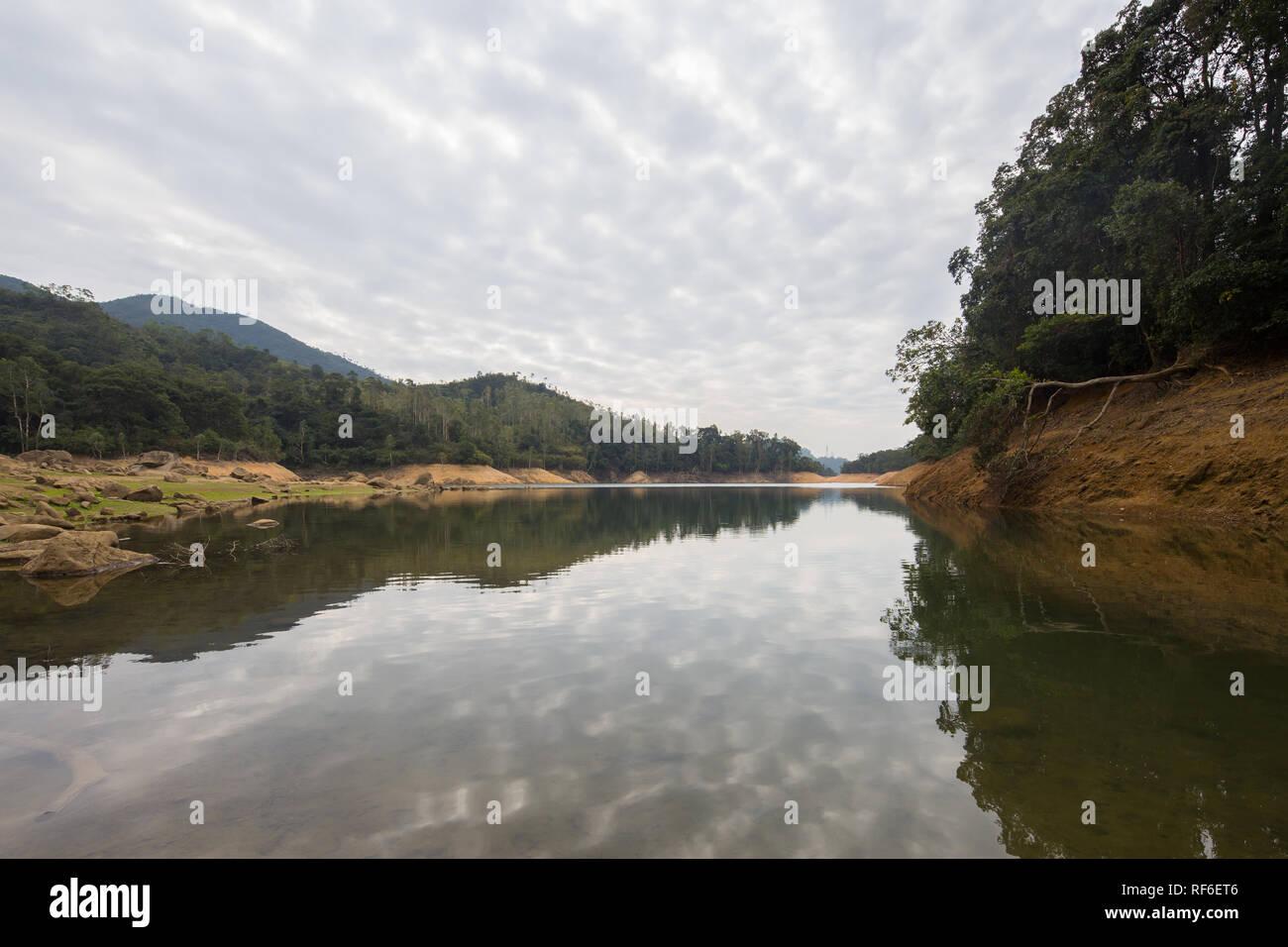 Reflection of the sky on Shing Mun Reservoir, Hong Kong - Stock Image