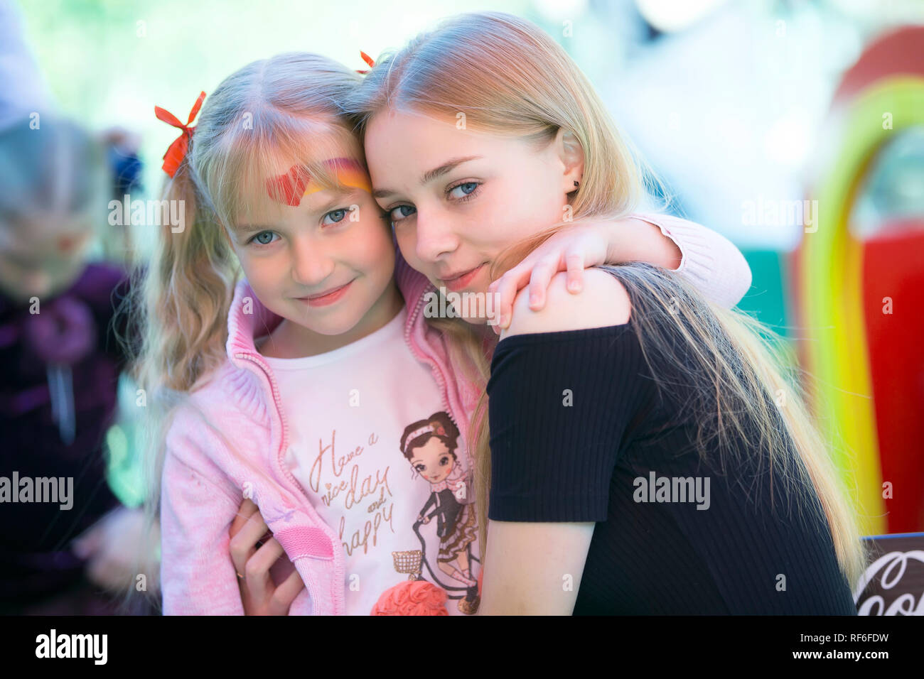 Holiday in the city. Children's Pavilion.Older sister and younger sister - Stock Image