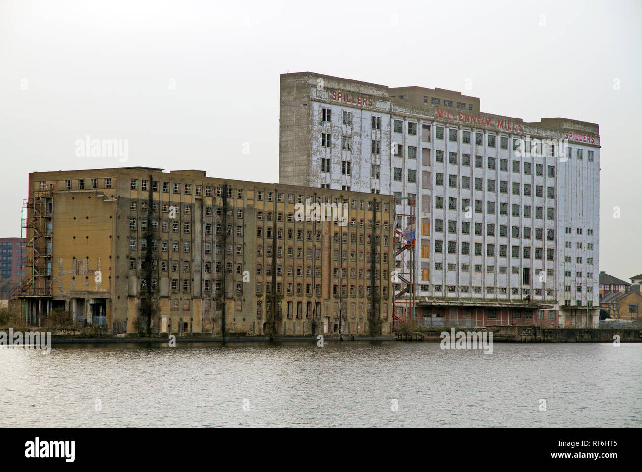 The former Rank Hovis Premier Mill and Millennium Mills derelict flour mill buildings in West Silvertown on the south side of the Royal Victoria Dock  - Stock Image