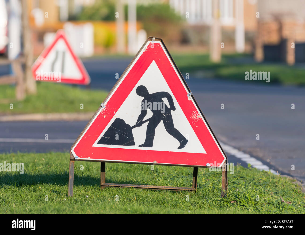 Triangular free-standing roadworks warning sign by the side of a road in England, UK. - Stock Image