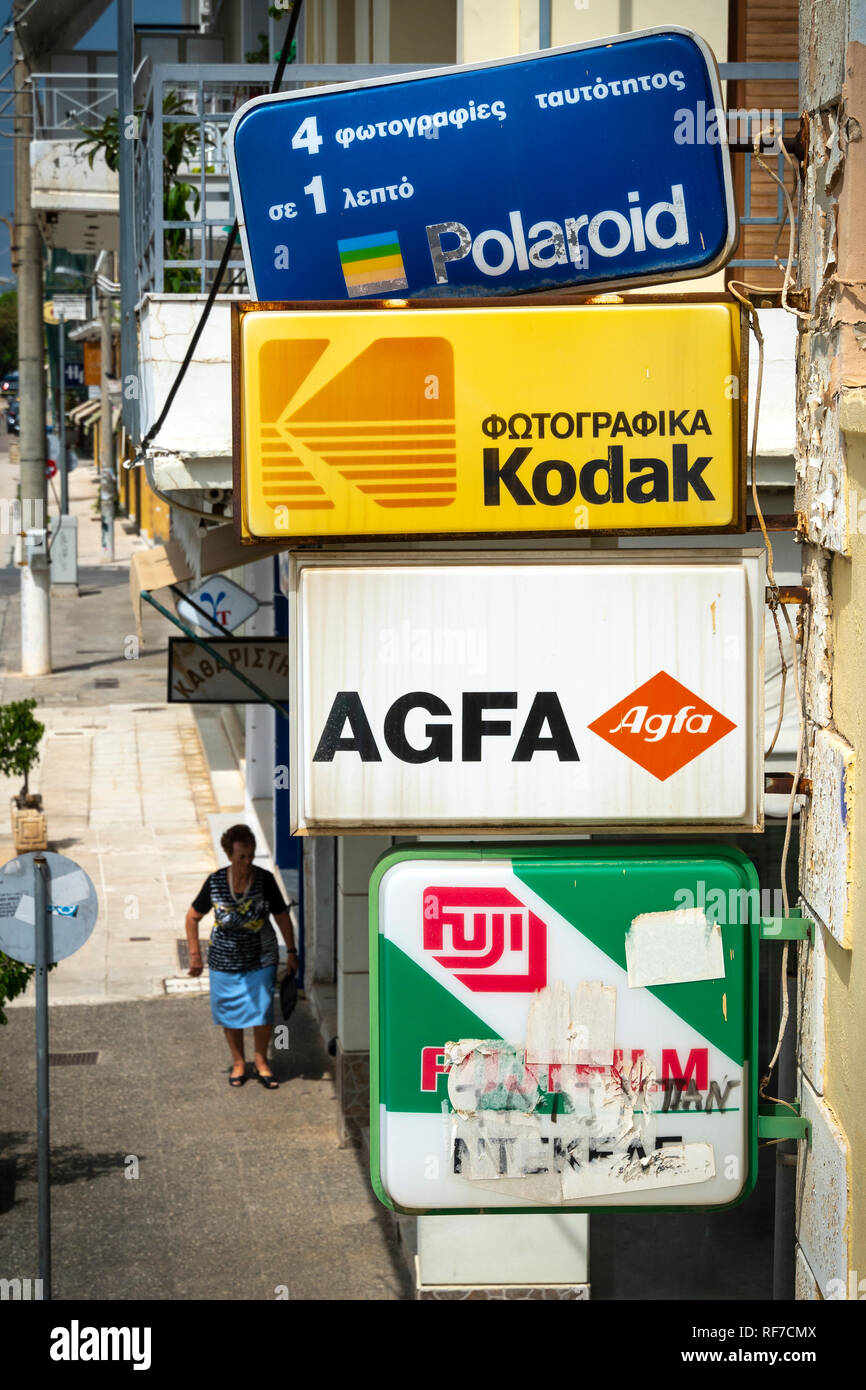 Old signs advertising a variety of photographic films above a photographers shop in Kalamata, Messinia, Southern Peloponnese, Greece. - Stock Image