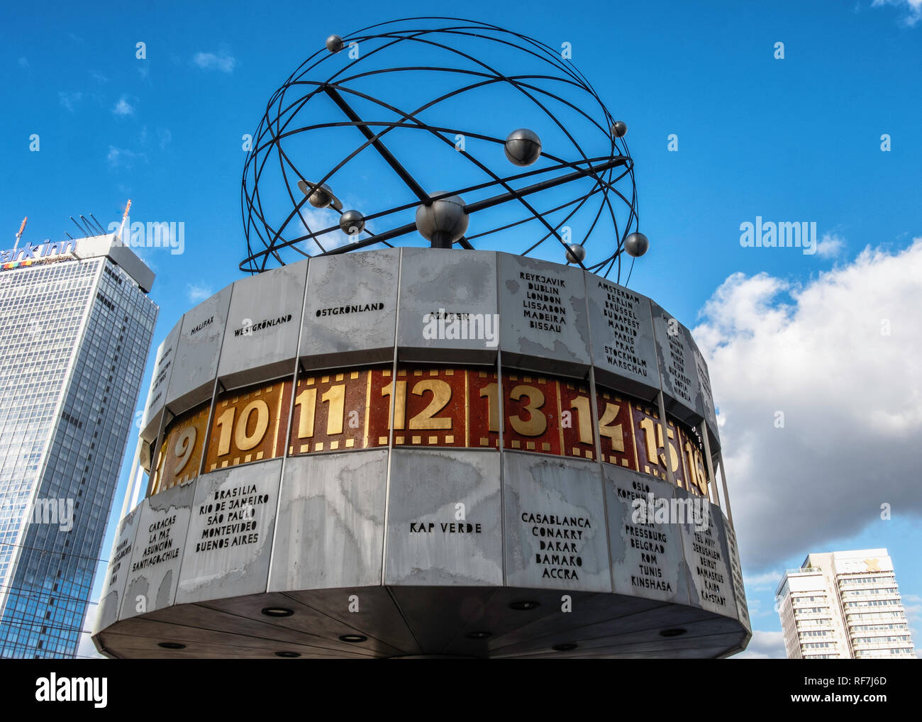 The World Clock or Urania Clock is large turret-style world clock at Alexanderplatz Mitte, Berlin.  It shows the current time of 148 world cities - Stock Image