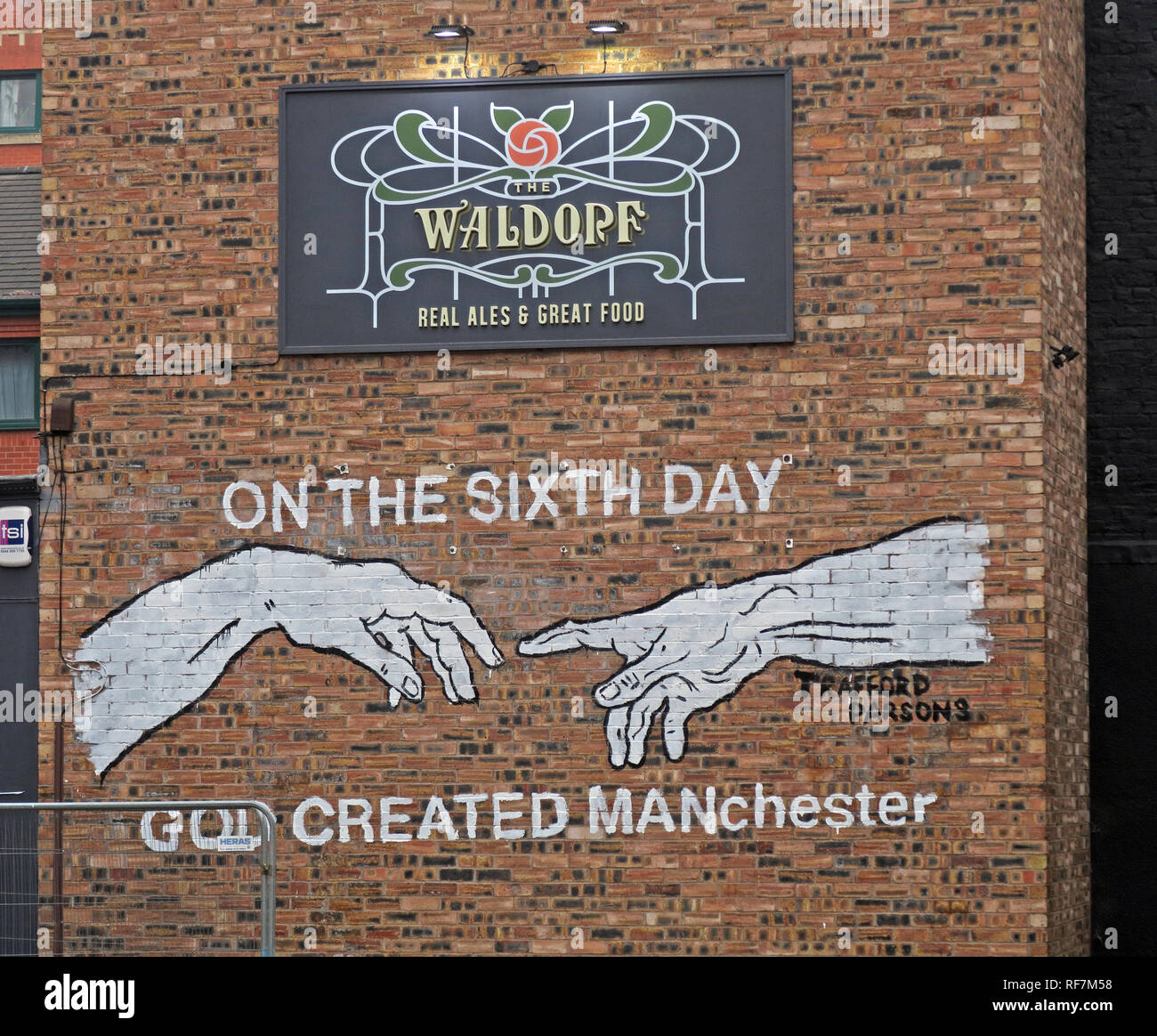 On the 6th Day God Created Manchester, Gable end,The Waldorf Pub Bar, Gore St, Piccadilly, Northern Quarter, Manchester, UK, M1 3AQ - Stock Image