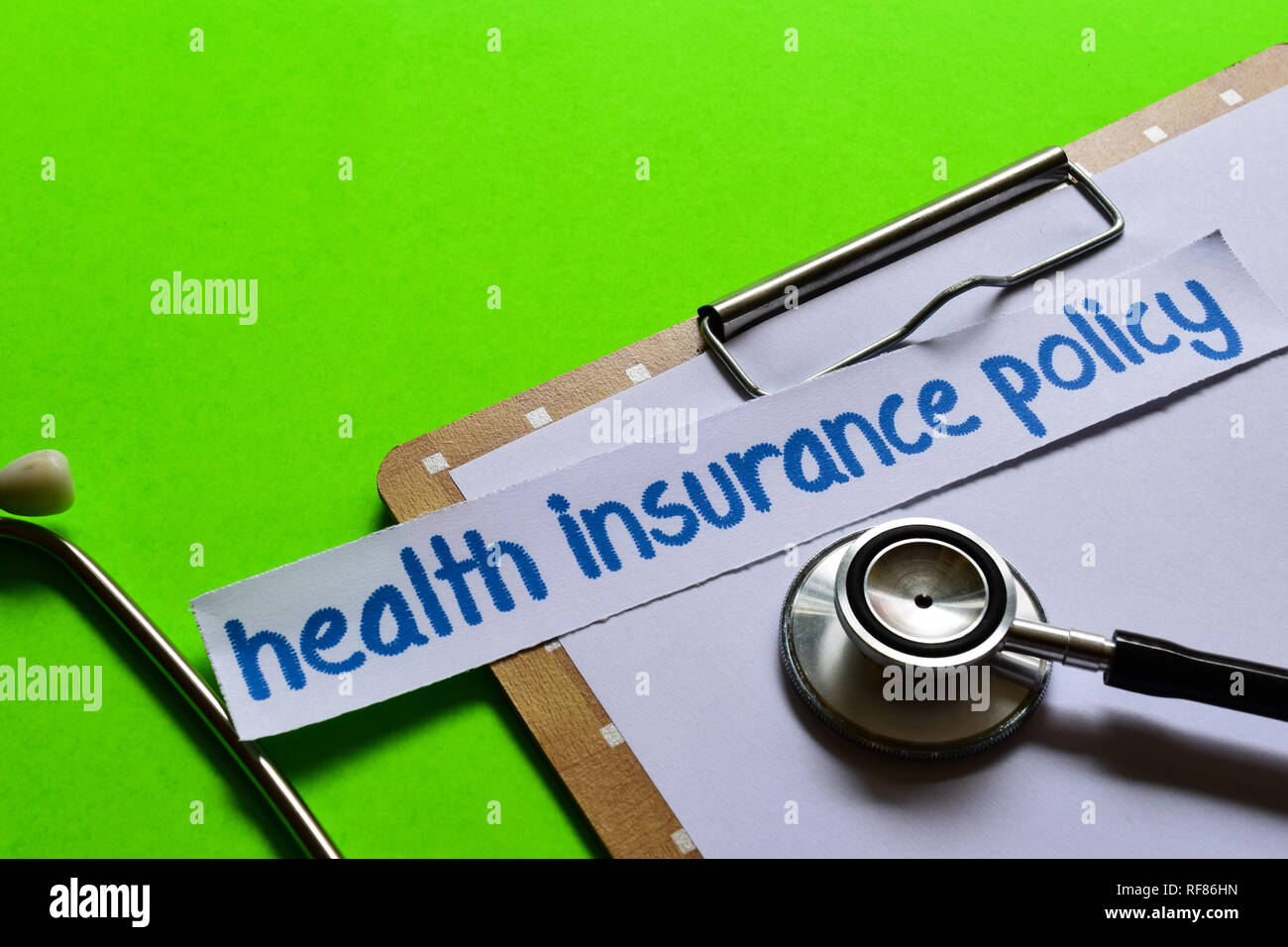 Health insurance policy on healthcare concept inspiration with green background - Stock Image
