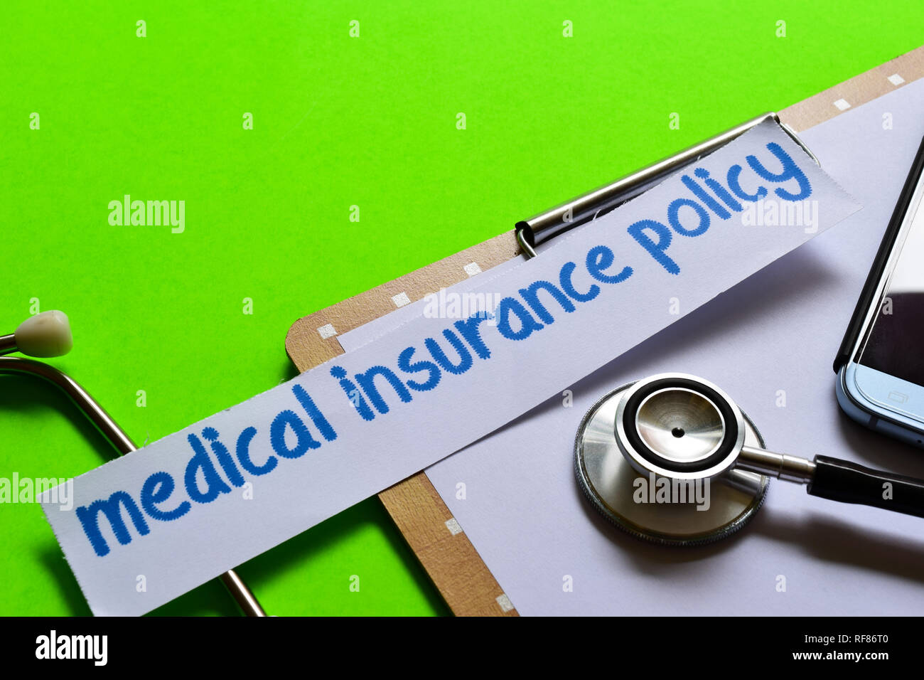 Medical insurance policy on healthcare concept inspiration with green background - Stock Image