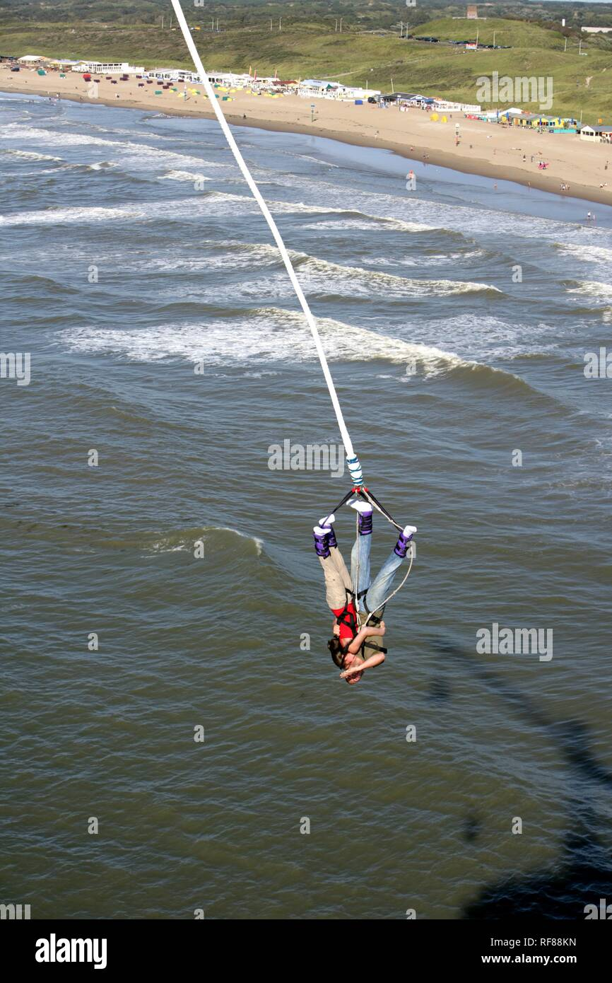 Bungee Jumping from the pier over the North Sea, Scheveningen, The Hague, The Netherlands, Europe Stock Photo