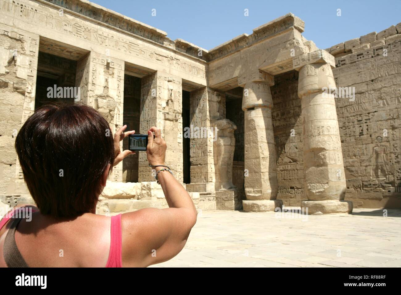Tourist, Medinet Habu, Mortuary Temple of Ramesses III, West Thebes, Luxor, Egypt, Africa Stock Photo