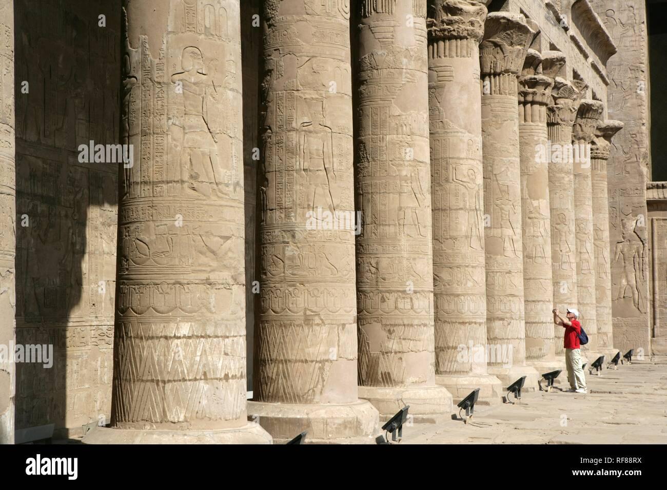 Tourist at the Temple of Edfu (dedicated to the falcon god Horus), Edfu, Egypt, Africa Stock Photo