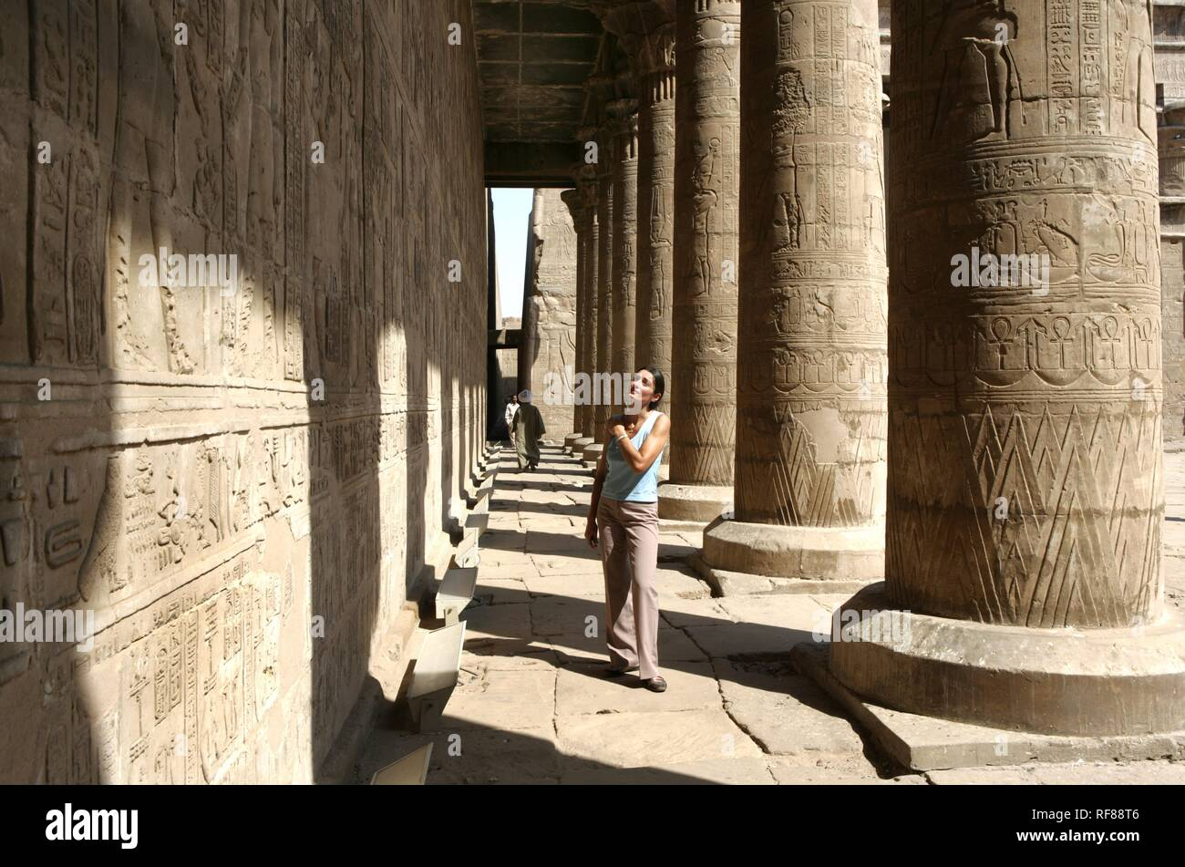 Tourist at the Temple of Edfu (dedicated to the falcon god Horus), Edfu, Egypt, Africa Stock Photo