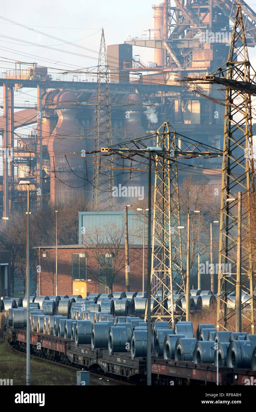 Freight train carrying a load of strip steel rolls, ThyssenKrupp Steelworks, Duisburg, North Rhine-Westphalia - Stock Image